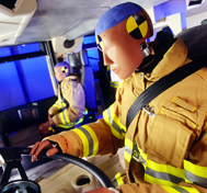 Test dummies sit inside a fire apparatus cab awaiting a CAPE rollover test.