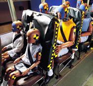 A variety of test dummies are shown aboard a school bus prior to a barrier block crash test at CAPE.