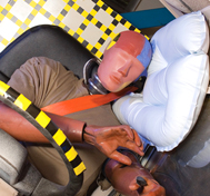 Test dummy lays on its side after a rollover test where RollTek was deployed.