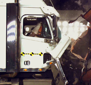 White semi truck crashes in CAPE's barrier block during a test demonstration.